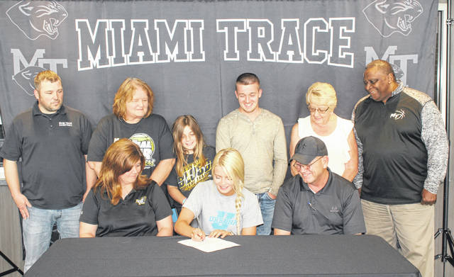 Miami Trace High School senior Cassidy Lovett, seated, center, signs a letter of intent to attend Urbana University where she will pursue a degree in education and be a member of the Blue Knights basketball team. She is flanked by her parents, Stacy and Roger Lovett and joined by (standing, l-r); Ben Ackley, Miami Trace girls basketball coach, her grandmother, Gaye Huffman, her sister, Gracie and brother, Dylan, her grandmother, Nancy Lovett and Carlos Roberts.