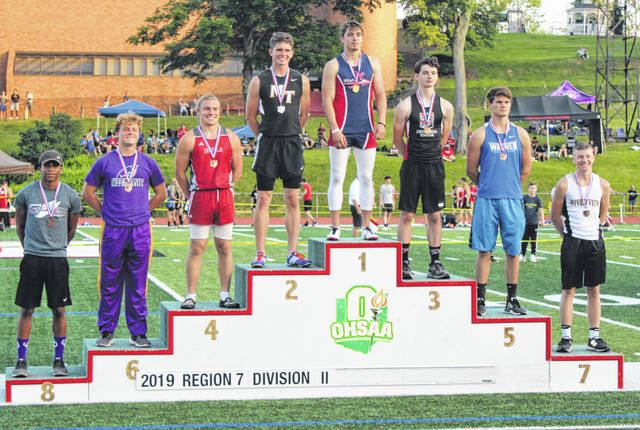 "Miami Trace's Wyatt Cory stands in second place on the podium at the Regional track meet for the pole vault Thursday, May 23, 2019. Cory qualified to the State meet with a height of 13' 10""."