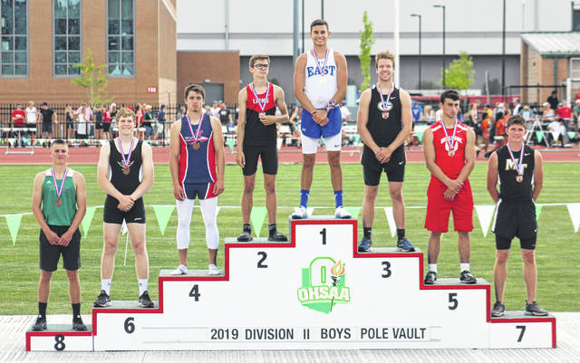 "Recent Miami Trace High School graduate Wyatt Cory, at right, stands on the State podium in seventh place in the Division II pole vault Friday, May 31, 2019 at the Jesse Owens Memorial Stadium on the campus of The Ohio State University. Cory's finish makes it five years in a row that someone from Miami Trace has placed at the State meet. Wyatt Cory goes over the bar in the Division II pole vault at the 112th annual boys State track meet Friday, May 31, 2019 at The Ohio State University. Cory placed seventh out of 18 competitors with a height of 14' 2""."