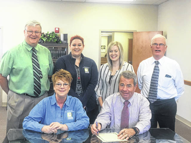 The Fayette County Commissioners and staff of Fayette County Job and Family Services met Monday morning to sign the proclamation. Pictured in the back row (L-R) are Commissioner Dan Dean, fraud investigator Paula Resor, supervisor Stephanie Loyd and Commissioner Jim Garland. Pictured in the front row (L-R) director Faye Williamson and Commissioner Tony Anderson.