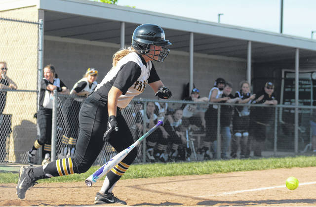 Miami Trace's Kylee Rossiter puts down a sacrifice bunt in the second inning of a Division II Sectional championship game against Logan Elm Wednesday, May 8, 2019 at Miami Trace High School.