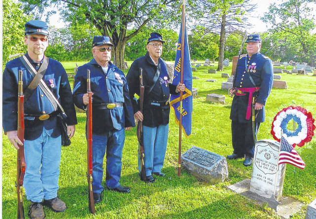 Members of Company C, 20th Ohio Volunteer Infantry, Sons of Veterans Reserve, the military component of Henry Casey Camp 92 Sons of Union Veterans of the Civil War, place a floral wreath at the grave of Civil War Medal of Honor recipient, 1st Lt. David Jones, who is buried in the Good Hope Cemetery. Left to right: Shawn A. Cox, James L. Grim, Terry Cochran and unit Commander Capt. Shane Milburn.