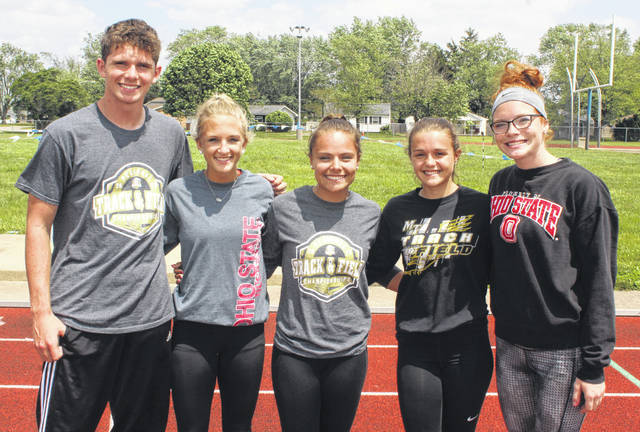 Miami Trace High School's State track meet qualifiers practiced this week at Washington High School in preparation for the big 2019 season-ending two-day event in Columbus. (l-r); Wyatt Cory, pole vault; Macy Creamer, 100-meter dash, 300-meter hurdles and 4 x 100-meter relay and Lilly Litteral, Alyssa Butler and Isabella Vanover, 4 x 100-meter relay.