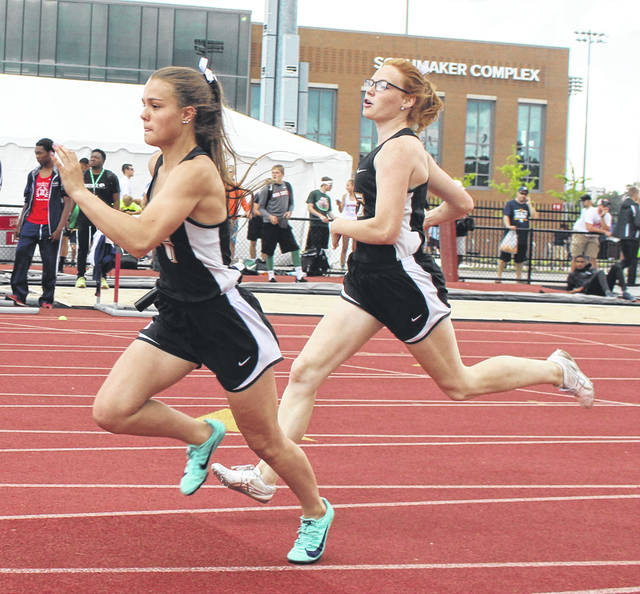 Alyssa Butler (left) begins her leg of the 4 x 100-meter relay after receiving the baton from Isabella Vanover (right) during Miami Trace's run at the State track meet at The Ohio State University Friday, May 31, 2019. The team of Butler, Vanover, Lilly Litteral and Macy Creamer set a new school record Friday with a time of 50.80.