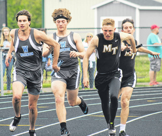 The Washington Blue Lions and Miami Trace Panthers run side by side during the first exchange of the 4 x 100-meter relay at the Miami Trace Invitational Thursday, May 2, 2019 at MTHS. (l-r); Trent Langley and Jamie McCane of Washington and Jake Atwood and Keegan Terry.