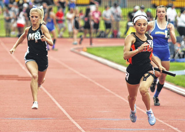 Miami Trace's Macy Creamer, left, anchors the 4 x 100-meter relay at the 45th annual girls State track meet Friday, May 31, 2019. Later on Friday, Creamer broke her own school record to advance to the finals in the 300-meter hurdles.