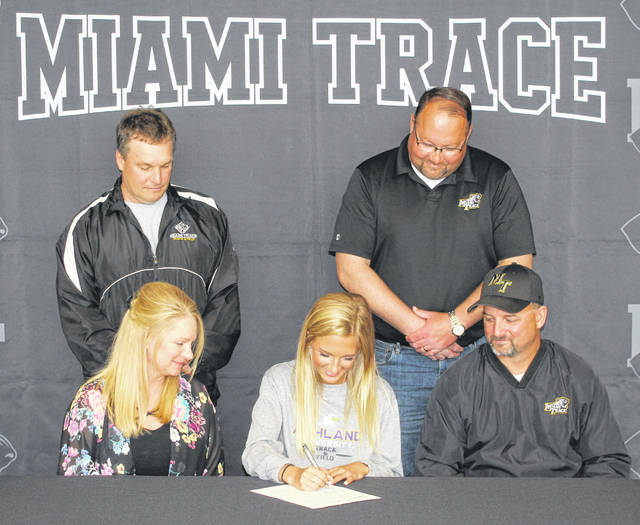 Miami Trace senior Macy Creamer, seated, center, signs a letter of intent to attend Ashland University where she will study forensic biology and compete on the Eagles' track and field team. Creamer is joined by her parents Sue Thomas and Jeff Creamer and her coaches, (standing, l-r); Chip Wilt and Brent Noes.