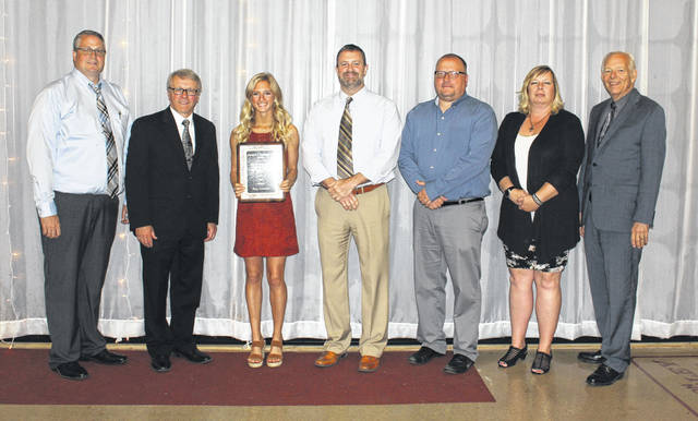 Macy Creamer, third from left, was named the 2019 Clarence A. Christman Award winner at a luncheon Wednesday afternoon. She is joined by administrators from Miami Trace High School and representatives of the Record-Herald and Kiwanis Club, who sponsor the award annually. (l-r); Aaron Hammond, Athletic Director; Rob Enochs, Principal; Creamer; David Lewis, Superintendent; Ryan Carter and Kim Penwell of the Record-Herald and Roger Kirkpatrick of the Kiwanis Club.