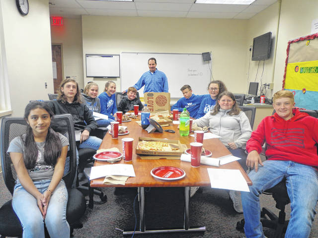 "Donatos recently provided pizza to these students at Washington Middle School as they celebrated ""Pizza with the Principals."" This is in appreciation for their selection as Students of the Month for May. They are chosen by their teachers because of the outstanding example they set for their peers in such areas as academic effort, good work ethic, kindness to others, and service to their school. Pictured (L to R): Jessica Lopez Domingues, Justin Grove, Kendall Dye, Megan Sever, Brendon Peters, Mr. Wayne, Principal, Mason Coffman, Abby Wilson, Brianna Grooms and Corey Kennedy. Absent from picture - Calum Brown."