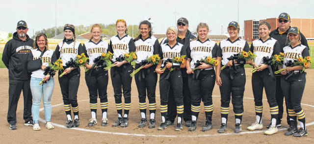 The Miami Trace Lady Panthers softball team recognized their 10 seniors prior to the game against Hillsboro Monday, April 29, 2019. (l-r); coach Chris Ford, Breanna Eick, Billie Jo Seitz, Jessica Camp, Kaylee Hauck, Olivia Wolffe, Cassidy Lovett, head coach Joe Henry, Maddie Mossbarger, Ashley Campbell, Krissy Ison, coach Shawn Grooms and Kylee Rossiter.