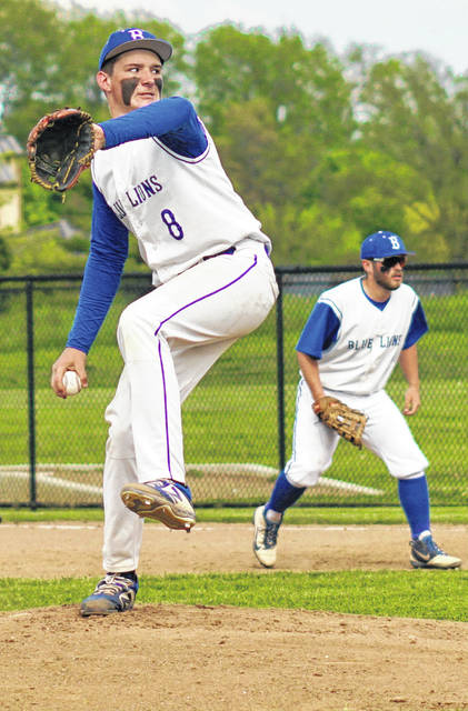 R.G. Crabtree delivers a pitch for Washington during a non-conference game against Franklin Monroe Tuesday, May 7, 2019 at Washington High School. Also pictured for the Blue Lions in Bailey Roberts.
