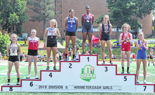 Washington's Rayana Burns (standing 2nd) became an 8-time State track and field qualifier when she placed second in the finals of the 400-meter dash at the Division II Regional track meet Saturday, May 25, 2019 in New Concord.