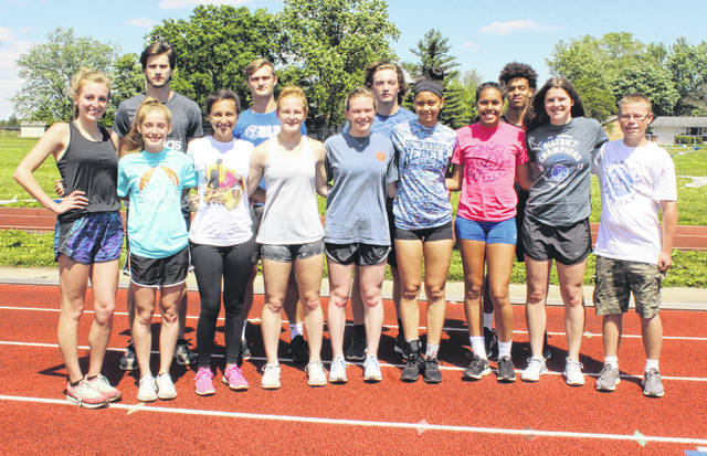 Washington High School's Regional track meet qualifiers on the track at Washington High School prior to practice Monday, May 20, 2019. The Regional meet begins Thursday at Muskingum University with field events at 5 p.m. and track events starting at 6 p.m. (front, l-r); Cloe Copas, 1600 and 3200-meter runs; Chloe Lovett, 300-meter hurdles, 4 x 200-meter relay, 4 x 400-meter relay; Kayla Welling, 4 x 200-meter relay; Tabby Woods, 4 x 200-meter relay, 4 x 400-meter relay; Halli Wall, 4 x 200 and 4 x 400-meter relays; Jeleeya Tyree-Smith, high jump; Rayana Burns, 400-meter dash, 4 x 400-meter relay; Shawna Conger, shot put; Joey Pickelheimer, track team manager; (back, l-r); Trent Langley, 110 and 300-meter hurdles, 4 x 100-meter relay; Eli Lynch, 4 x 100-meter relay; Jamie McCane, 4 x 100-meter relay; Jerome Mack, 4 x 100-meter relay. Not pictured: Sterling Smith, shot put; Megan Downing, pole vault; Hannah Haithcock, shot put.