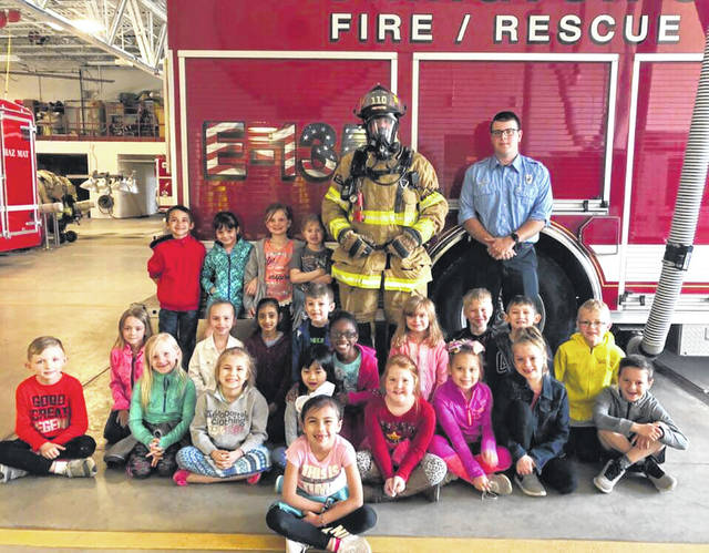 Mrs. Wahl's first grade class decided that they would like to help the community learn about fire safety. After writing their own fire safety book the class visited the Washington Fire Department to take a tour and give a copy of the book to the firefighters.