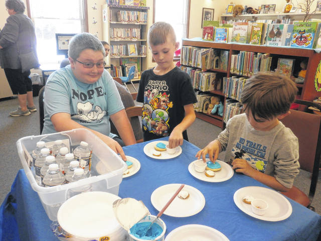 Will, Kyler and Sam were just three among many that came to experience Cosmic Cookies and an Out-Of-This-World Drink recently at Miss Susan's delicious cookie program at Jeffersonville Branch Library.