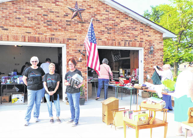 Pictured are three of the Altrusans who unselfishly contributed their time to this year's garage/bake sale at the home of Mary Sue Spengler: Nancy Mowery, Lori Cockerill and Shelia Johnson.