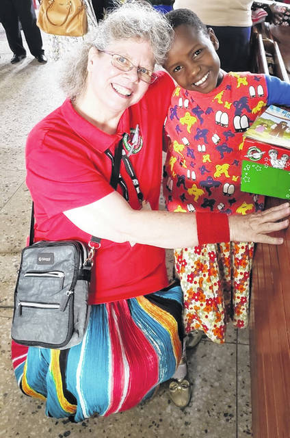 Barbara Lanctot (L) of Wilmington traveled to Tanzania with a group of volunteers to distribute Operation Christmas Child shoebox gifts to children in and around the capital city of Arusha.