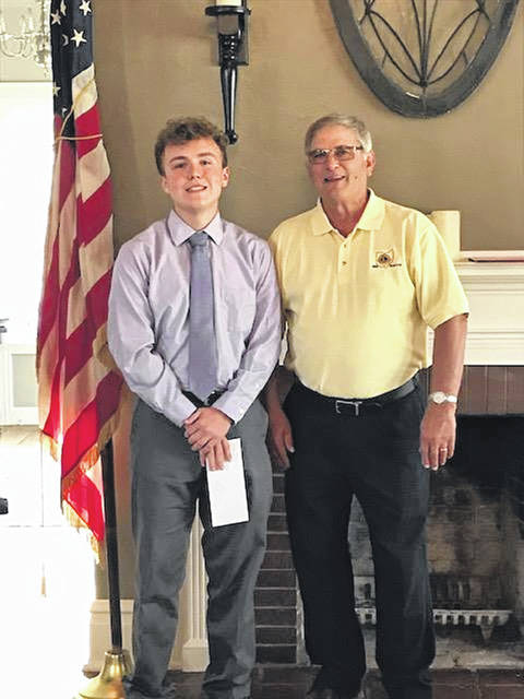 The Washington Lions Club met recently to award their annual high school scholarships. Recipients and their parents were invited as dinner guests of the club. Pictured are scholarship chair Ray Deeks (R) with Washington High School senior Jaxson Singleton (L). Singleton attended with his mother, Karen.