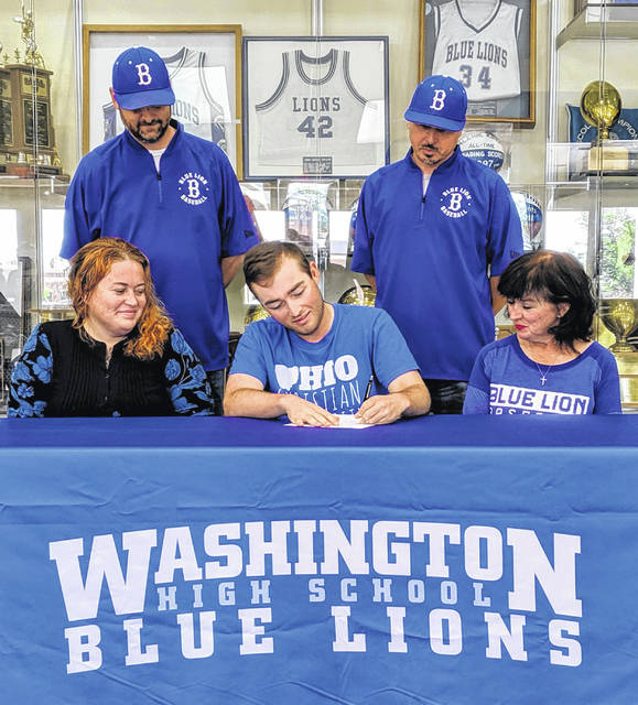 Bailey Roberts, seated, center, signs a letter of intent to attend Ohio Christian University. He is flanked by his mother, Allison Ball, left, and his grandmother, Susan DesMarais; (in back, l-r); Washington head coach Mark Schwartz and assistant coach Brandon Runk.