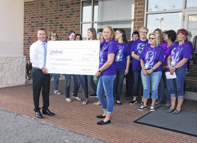 "Gordmans celebrated the opening of department stores in 25 Ohio communities on Thursday. In each of those communities, Gordmans chose a local high school to receive a $1,000 donation and Washington High School was chosen as the local recipient. The check was presented to Washington High School Principal Tracy Rose (L). Rose said, ""We have so many needs and are always looking for any contributions and any funding we can get to meet our students' needs and success."""