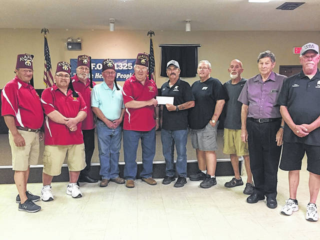 The Greenfield Eagles #1325 recently donated $5,000 to the Shriners Hospital for Children. This represents some of the Greenfield Eagles' charity work, and the Washington Shrine Club and the Shriners Hospital for children are very grateful for their generous gift. From left to right: Jeff Detty, Dan Maxie, Kenny Arnold, Steve Simpson, Warren Craig, Doug Templin, Dave Cokonougher, Donnie Kier, Terry Karnes and Jim Wilson.