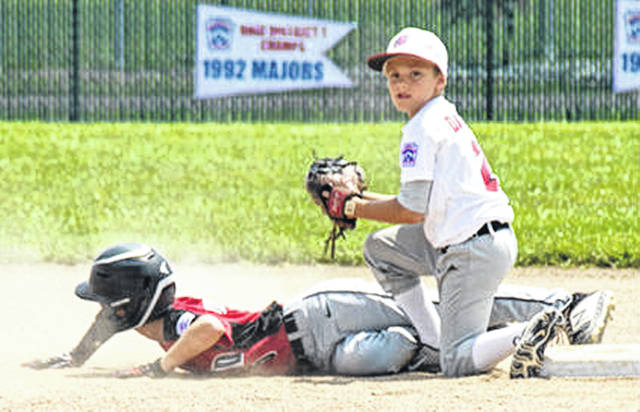 Carter Davidson tags a runner out at second base for the Washington C.H. 10-year-old all-star team at the Little League State tournament over the weekend near Ashtabula, Ohio.