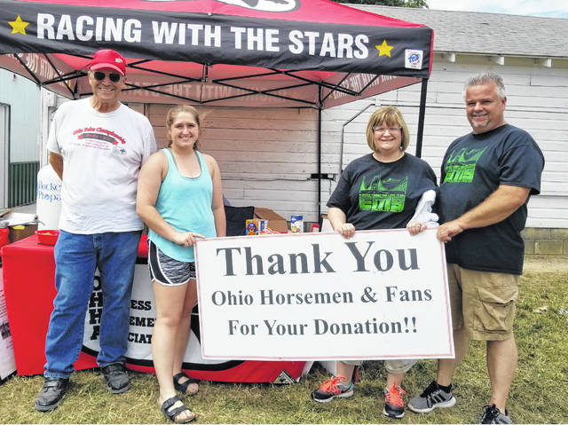 Lending a helping hand — (l-r); Thom Pye, O.H.H.A., Aubrey Schwartz, United States Trotting Association youth delegate, and representatives from Rose Avenue Community Center, Kellie and Mark Michael.