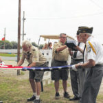 Boy Scouts, veterans honor flag