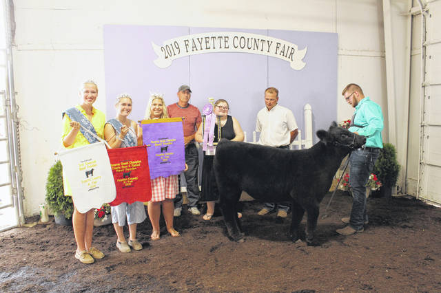 Madison Riley won the Reserve Champion Beef Feeder during Tuesday's show. Pictured (L to R): Fair Queen Attendant Andrea Robinson, Fair Queen First Attendant Tori Evans, 2019 Fayette County Fair Queen Abbi Pettit, Mike Rife, Madison Riley, judge Joe Beckett and assisting exhibitor Quinton Waits.