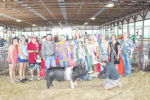 Kasi Payton won the reserve grand champion market hog at Wednesday's Fayette County Junior Fair Market Hog Show. Pictured are Lisa Payton, Peggy Payton, David Payton, Brian Down (the judge of the show), Payton, Fayette County Fair Attendant Andrea Robinson, Fayette County Pork Princess Alison Reeves, Fayette County Pork Princess Emily Reeves, Fayette County Fair Queen Abbi Pettit, Fayette County Fair First Attendant Tori Evans, Clinton County Junior Fair Princess Carrie Robinson and Fayette County Pork Queen Meri Grace Carson.