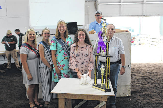 Meghan Cory's grand champion meat pen of two rabbits sold for $1,000 Wednesday night at the Fayette County Fair Rabbit Sale. Pictured with Cory from left to right are the buyer and fair royalty: Fayette County Fair Queen Abbi Pettit, Fayette County Fair First Attendant Tori Evans, Fayette County Fair Attendant Andrea Robinson and Roger Thompson, of Thompson Residential Engineering.