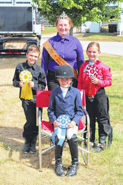 Karlee Johnson won the Walk-Trot Versatility Class. She is pictured Colton Osborne (third), 2019 Fayette County Horse Queen Linzy Turley and Peyton Zimmerman (second).