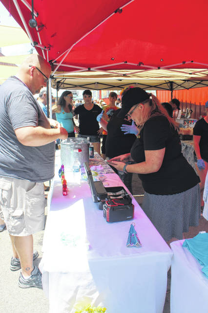 The first ever Fayette County Pride event was held on Saturday afternoon in downtown Washington C.H. with a large crowd attending at various times throughout the day. Salty Broads Patio — an upcoming downtown business — provided food for the event.