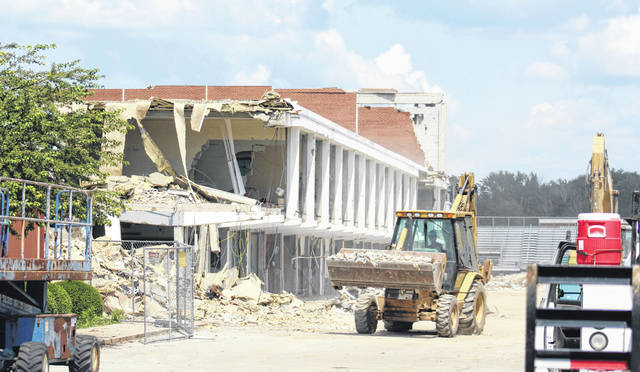 Work continues on the demolition of the original Miami Trace High School on a sunny Wednesday, July 24, 2019. The view above is from the SR 41 side looking east back toward the former main entrance to the building.