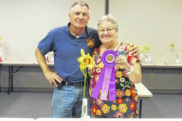 Best of Show winner Elaine Crutcher with Horticulture Judge Dan Bachman.