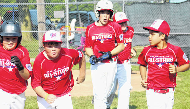 Members of the Washington C.H. all-stars return to the dugout after Lafe Coleman, center, hit the first of his two home runs during a District 8 Little League tournament game against Englewood Wednesday, July 10, 2019. (l-r); Alex Robinson, Brendan Peters, Coleman, Brysin Humphrey and Jakob Hoosier.