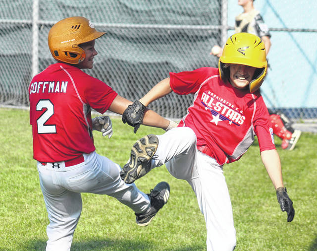 Gavin Coffman (left) celebrates with Xavier Lawhorn after Lawhorn hit an inside-the-park home run in the first inning of a District 8 Little League tournament game for the Washington C.H. 12-year-old all-stars playing against West Carrollton in a game played at Fairborn Little League Monday, July 8, 2019.