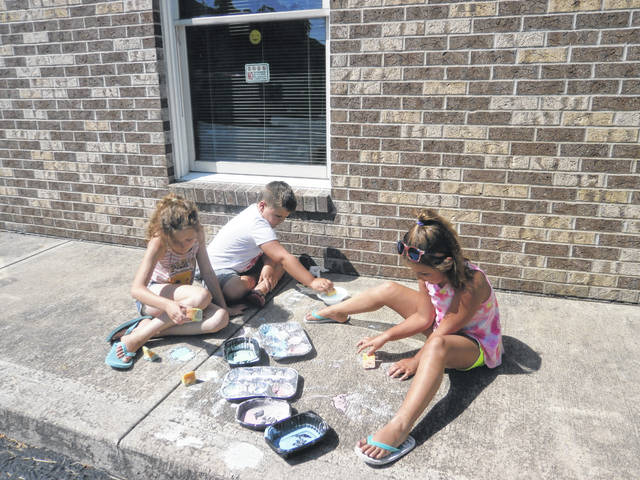 """In keeping with the Summer Library League theme, """"A Universe of Stories,"""" Becca, Jaden and Jordyn were able to do some Space Painting at Jeffersonville Branch Library."""