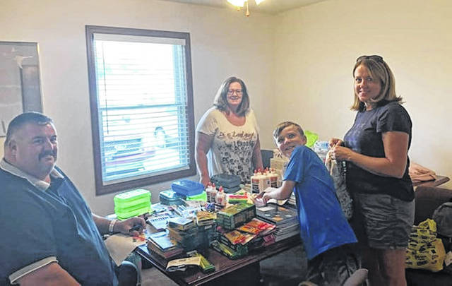 There were 40 backpacks put together for local school children. Supplies were sorted into the backpacks. Some of the sorters included (L-R) by Steven Armstrong, Ronda Turner, Justin Everhart and Audra Everhart.