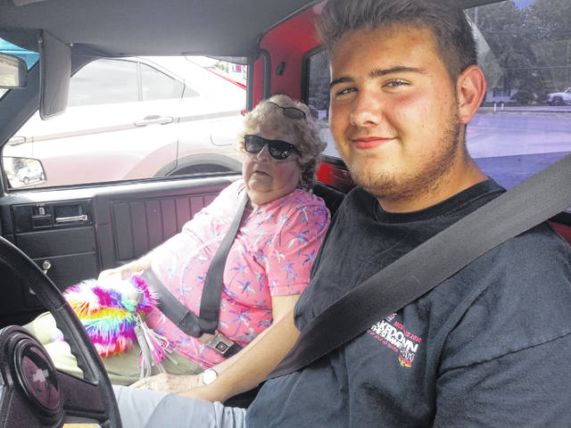 "Court House Manor resident Joretta Brunner (L) dropped by the Record-Herald office on Thursday with her great-grandson, Jayden Mitchel. Mitchel had just received his license on Wednesday. Brunner proudly said, ""I'm an 88 year-old great-grandma teaching my 16 year-old great-grandson how to drive a stick shift."" When Mitchell was asked if grandma's teaching him how to drive so he can take her places, he laughed and said, ""yes."""