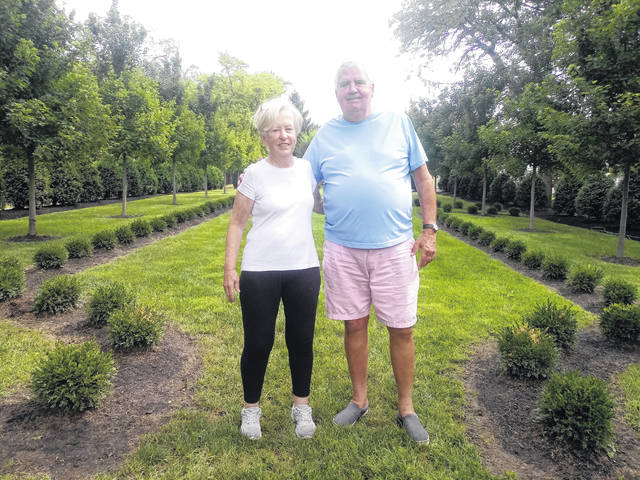 Clayton Hardy (L) has been working on renovations to the lot beside her home with the help of her husband, Alan Hardy (R). She bought the lot for a bid of $45,000. They then had the structure removed so she could renovate a garden.