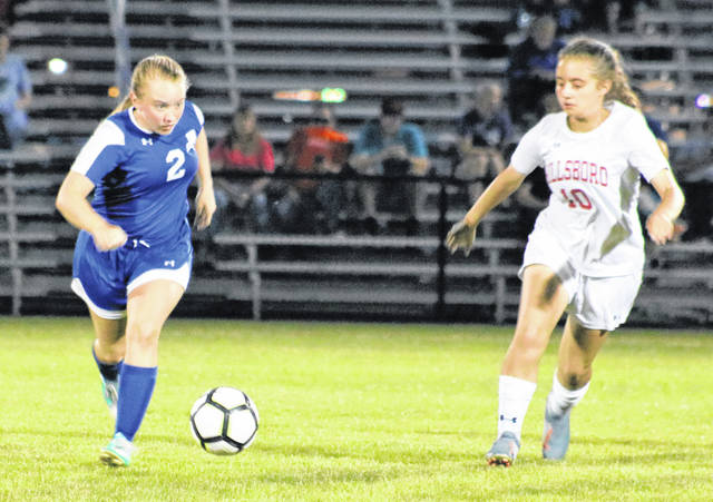 Washington's Arianna Heath (2) pushes the ball forward during a Frontier Athletic Conference match against Hillsboro Thursday, Aug. 29, 2019 at Washington High School. Hillsboro won the match, 11-0. Washington will play at Southeastern High School (near Chillicothe) Wednesday at 5 p.m.