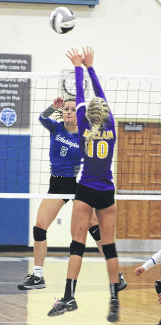 Washington's Brittney Wilson (5) hits past a McClain player during a Frontier Athletic Conference match at Washington High School Tuesday, Aug. 27, 2019.