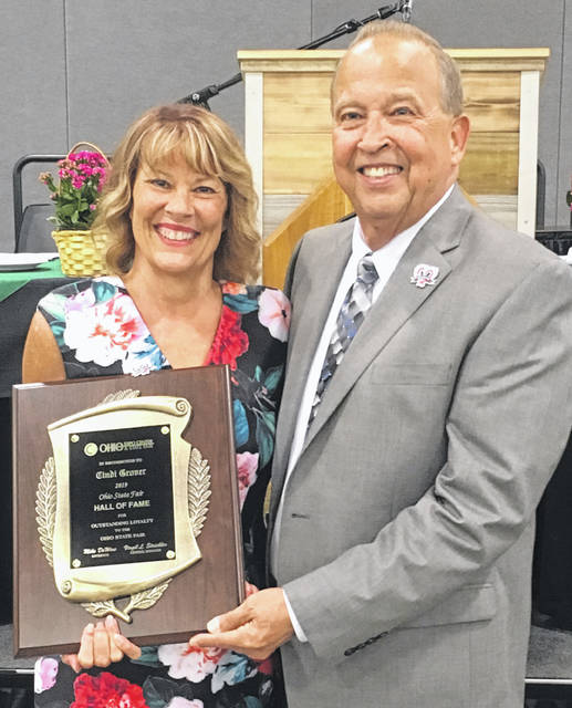 Cindi Grover was recently inducted into the Ohio State Fair Hall of Fame. She is pictured with OSF manager Virgil Strickler following the induction.