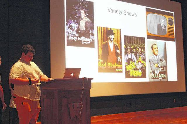 """As eighth grade language art students at the Washington Middle School prepare to read SE Hinton's """"The Outsiders,"""" they held """"mini-lessons,"""" according to teacher Derrick Lyons to help each other understand the mindset of the 1960s from movies to the Vietnam War. Cameron Brown-Wilson talked about the variety shows from the 60s while members of his group (Alexis Coy, Wesley Hayes and Luke Marsee) tackled important movies, actors, shows and television in general."""