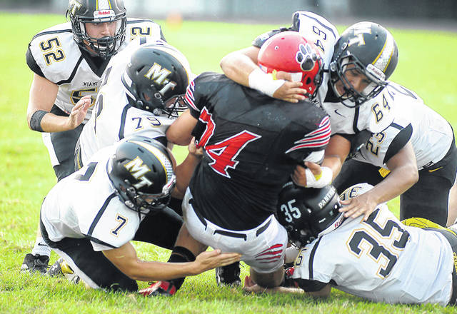 A half dozen Miami Trace Panthers converge to bring down Circleville's Cade Burton during the season-opening game at Circleville High School Friday, Aug. 30, 2019. Pictured for the Panthers: Luke Henry (52), Luke Anders (79), Mason Snow (7), Kenny Wolffe (64), Jaydenn Terry (23) and Austin Carpenter (35).