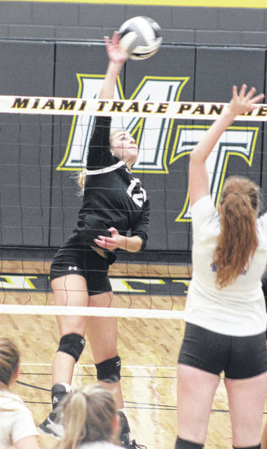 Miami Trace's Olivia Fliehman (12) returns the ball over the net during a Frontier Athletic Conference match against Chillicothe at Miami Trace High School Thursday, Aug. 29, 2019.