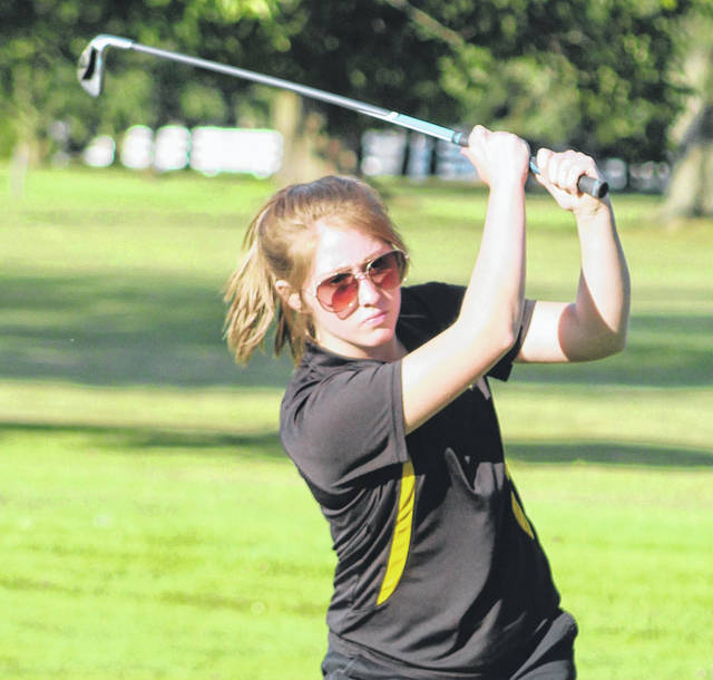 Miami Trace's Regan Hagler hits an approach shot to the green during a Frontier Athletic Conference match at The Greens Wednesday, Aug. 28, 2019.