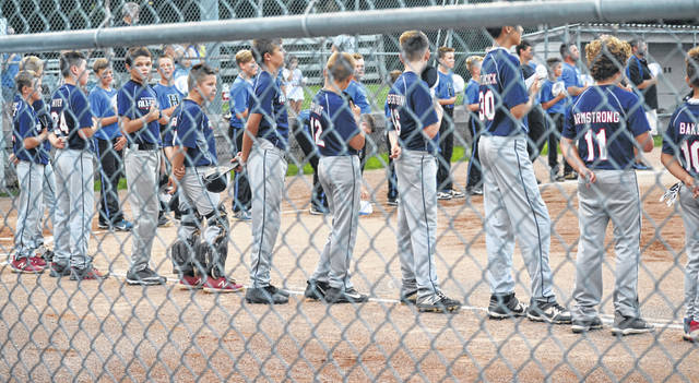 The Washington C.H. 11-year-old all-star team lines up for the National Anthem and Little League pledge prior to a game at the Little League State tournament, July, 2019 in Cambridge, Ohio.