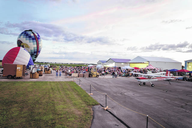 "The Fayette County Airport hosts the annual event ""Toast to Summer & Hot Air Balloon Glow."""